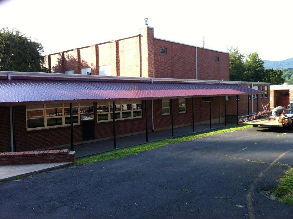 fabric commercial systems awning residential barrel awnings vestis buildings for quarter tony s and